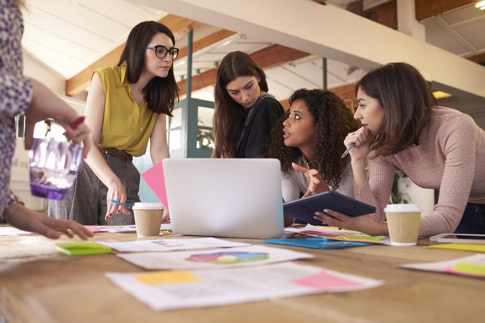 Female Realtors Having Brainstorming Meeting